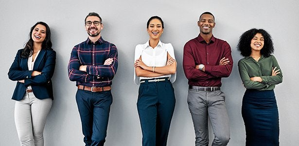 Studio shot of a group of businesspeople standing in line against a grey background Multi-Ethnic Group.